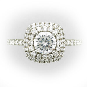 engagement ring has a double halo setting for a 0.75 carat center stone and has 0.54 carats diamonds on the band and around the center stone.