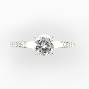 white gold 14 karat ring has 1.0 carat round stones on the side and 2 baguette cut stones with a 0.44 carat total weight.