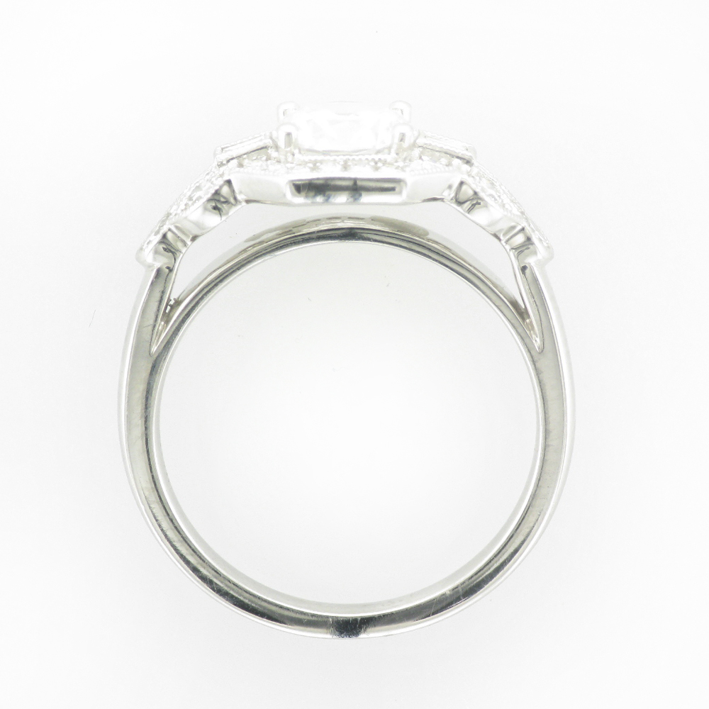 14 karat white gold ring has a deco design that will hold a 1.0 carat stone in the center and has 0.57 carats of side stones.