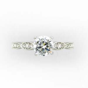 14 karat white gold ring has prongs for a 1.0 carat center stone and has 0.26 carats of side stones.