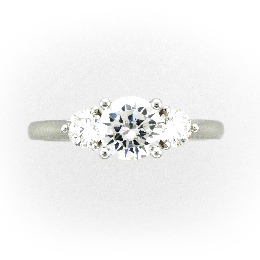 classic white gold diamond engagement ring has setting for a 1.0 carat Center Stone with 0.47 total carats of diamonds next to it.