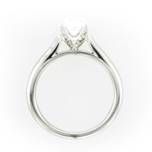 14 karat white gold solitaire ring has diamonds in the prongs with a total carat weight of 0.19 and the rating of FG/VS.