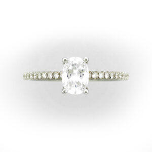 engagement ring has a setting for a oval stone and 0.37 carats of diamonds on the band with a FG/VS rating.