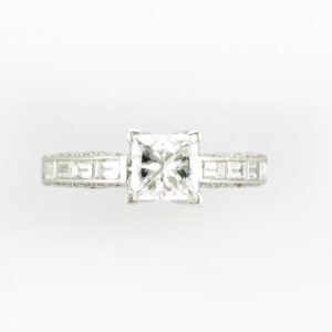 platinum ring as a 1.02 carat princess cut diamond with a GIA rating of H/VS2, it also has pave set and baguette diamonds with a total carat weight of 1.37.