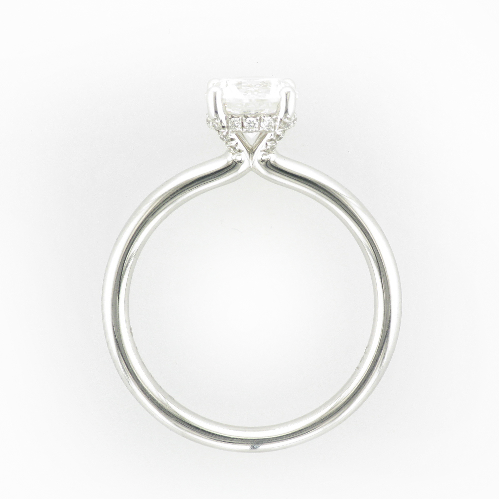 14 karat white gold Solitaire has diamonds set along the prongs with the total carat weight of 0.12.