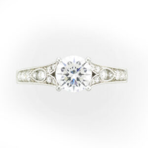 14 karat white gold ring has a band that is beaded and engraved and holds 0.30 carats in stones.