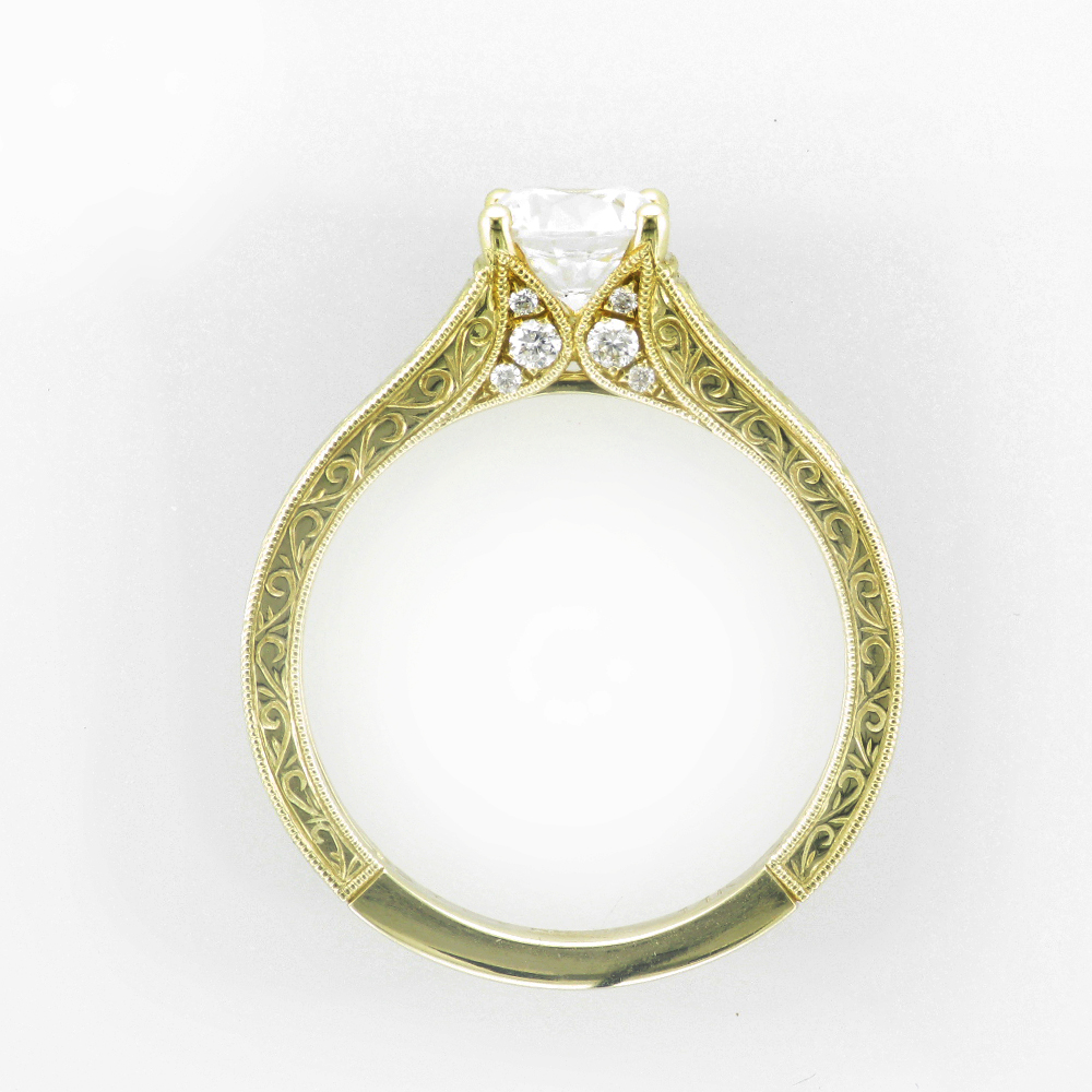14 karat yellow gold engraved engagement ring has a total weight of 0.10 carats of diamonds.