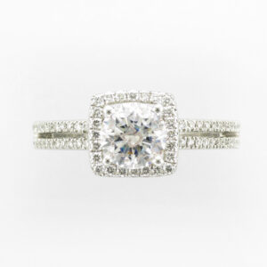 14 karat white gold ring has a square double shank Halo setting that can hold a round or square 1.0 carat stone, and has a total 0.29 carats of stones on the band.