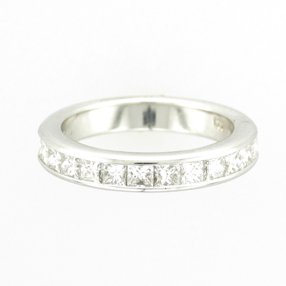 14 karat white gold band has 10 princess cut channel set diamonds with a total weight of 1.0 carrots and a rating of G/VS.