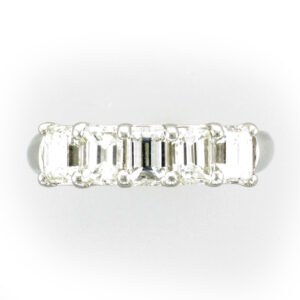 platinum ring as 5 emerald cut diamonds a total weight of 2.35 carrots and a rating of F/VS.