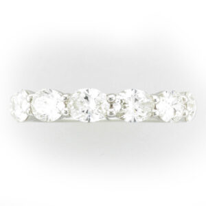 Platinum ring has 7 oval shaped diamonds with share prongs, total weight of 2.13 carrots, and a rating of F/VS.