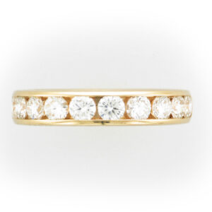 18 karat rose gold ring has 10 Channel set diamonds
