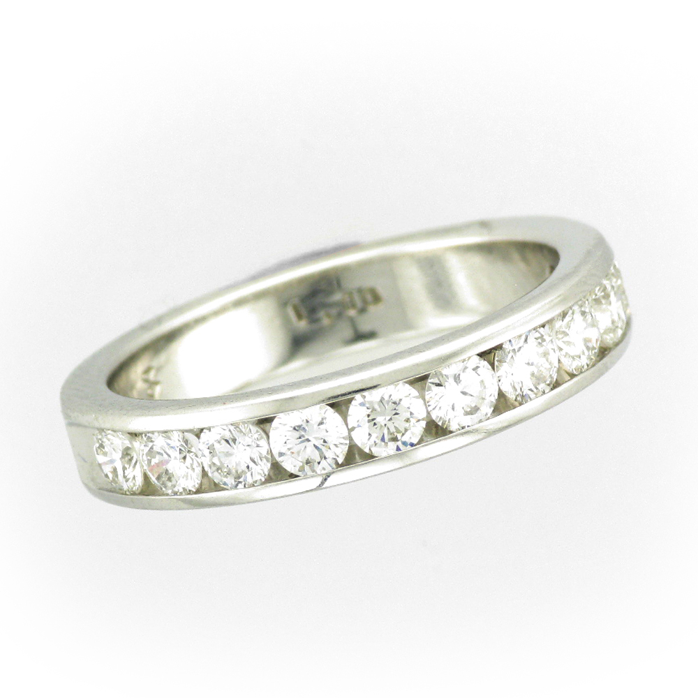 Platinum ring has 11 Channel set diamonds with a total weight of 1.0 carats and a rating of G/SI1. ring is size 7.