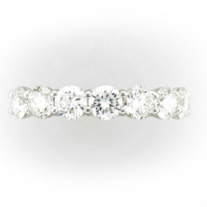18 karat white gold ring has 7 diamonds