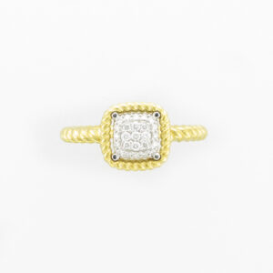 This 18 karat yellow gold ring has a rope pattern band and pave setting with a total weight of 0.16 carats.