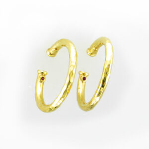These hoop earrings are made out of hammered 18 karat yellow gold.