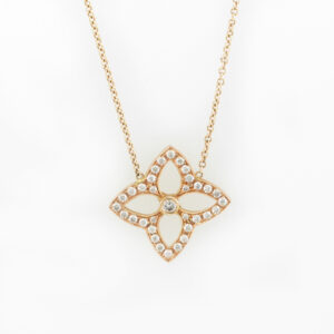 This 14 karat rose gold floral design necklace has 33 stones with the total weight of 0.68 carats and is on a 16 inch cable chain.