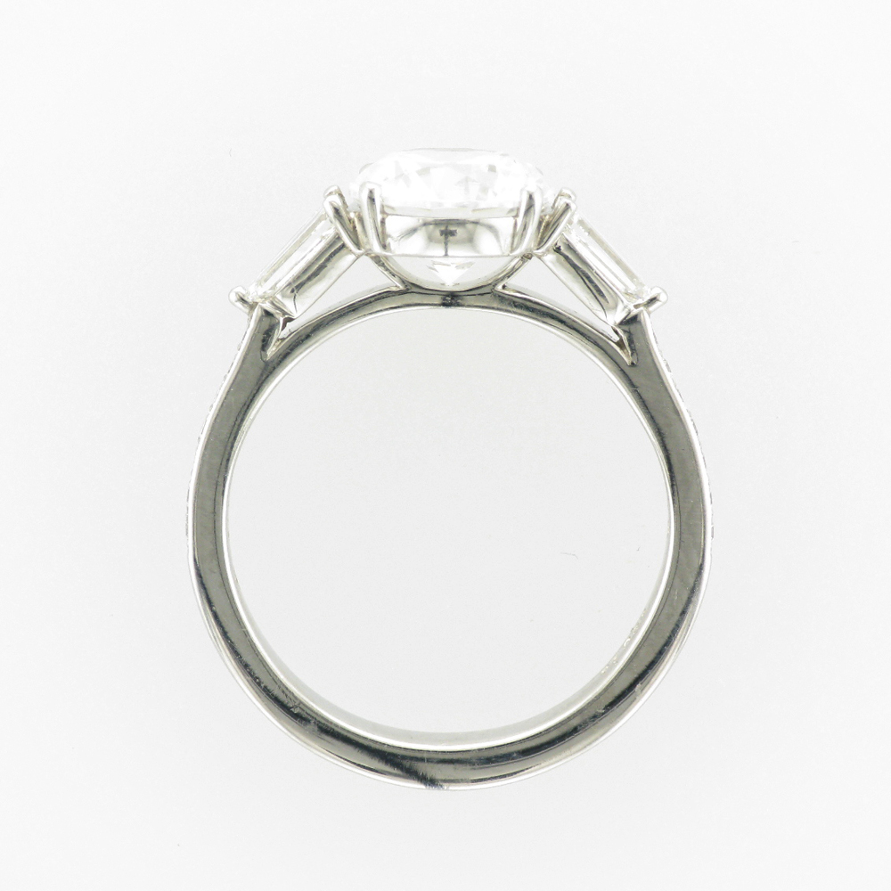 This platinum engagement mounting for a 2 carat stone has two longer side diamonds with a total carat weight of 0.47 and 14 smaller diamonds with a total weight of 0.11 carats.