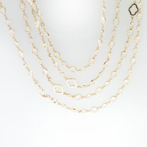 This 18 Karat Rose Gold is 48 inches long and has white topaz the entire length for a total weight of 34.89 carats.