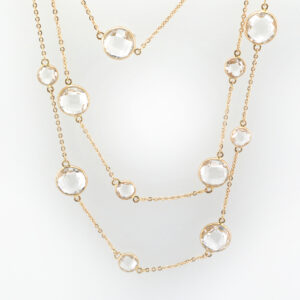 This 18 karat rose gold necklace has checkerboard cut white topaz with a total weight of 45.69 carats.