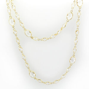 This 18 karat yellow gold necklace is 18 inches long and has oval white topaz with a total weight of 13.53 carats.
