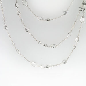 This 34 inch long 18 karat white gold necklace has oval and round bezel set white topaz with a total weight of 24.81 carats.