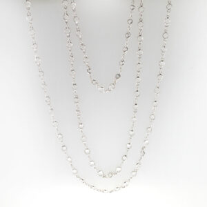 This 18 karat white gold necklace is 34 inches long and has bezel set white topaz with a total weight of 14.14 carats.