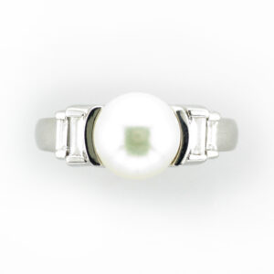 This ring has a 8.8 to 9 millimeter cultured pearl and 4 baguette diamonds with a total weight of 0.45 carats.
