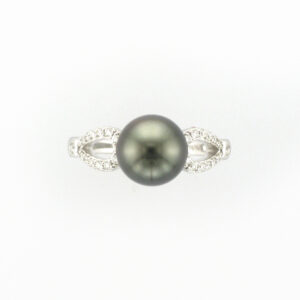 This 14 karat white gold ring has a 8.5 - 9 millimeter Tahitian pearl with 0.19 carats of stones on the sides.