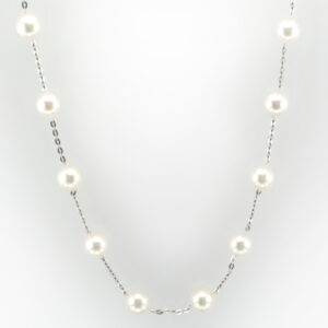 This tin cup pearl necklace is 16.5 inches and made of 14 karat white gold.