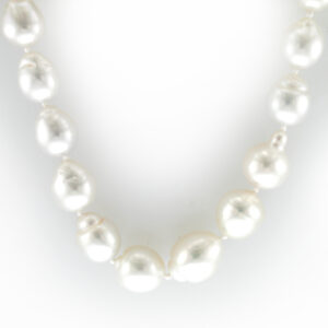 This necklace has 12.8 by 10 millimeter south sea baroque pearls and a 18 karat white gold ball clasp.