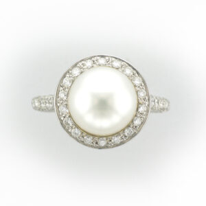 This 18 karat white gold ring has a 9.5 millimeter pearl with 0.90 carats of pave set diamonds with a rating of G/VS.