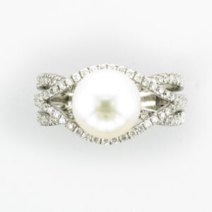 This 18 karat white gold ring has a 9.3 by 9.5 millimeter pearl and is surrounded by 0.75 carats in diamonds.