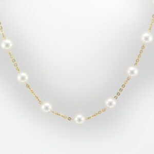 This tin cup pearl necklace is 16.5 inches long and made of 14 karat yellow gold.