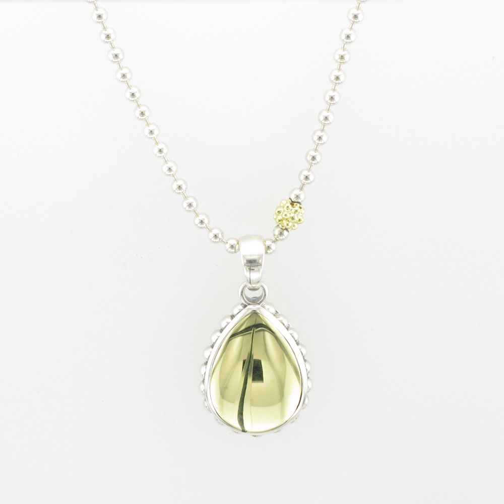 Gold and Silver Teardrop Pendant