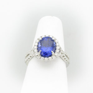 This 18 karat white gold ring has a 2.96 carat fine tanzanite in the center and diamonds with total carat weight of 0.78.