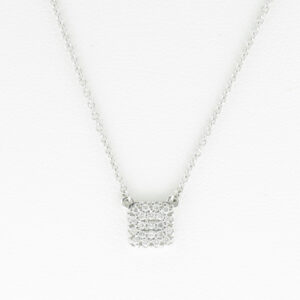 This 14 karat white gold necklace has a square pendant with pave set diamonds with a total weight of 0.18 carats.