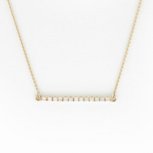 "This diamond bar necklace is made of 14 karat rose gold with an 18"" chain and 0.13 total carats of diamonds."