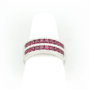 This band has 20 rubies with a total carat weight of 1.20 and 72 diamonds with a total weight of 0.24.