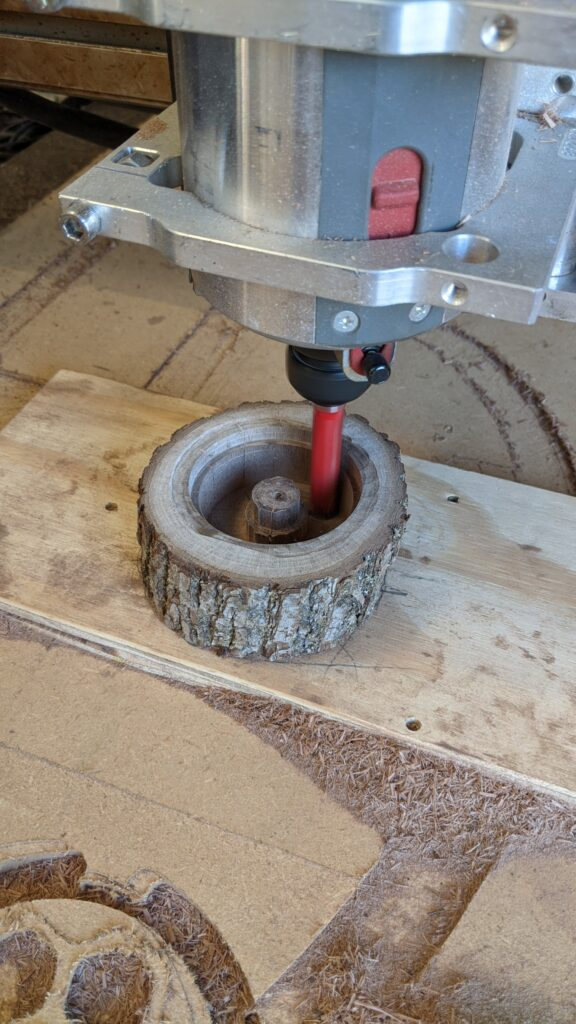 Walnut box with platinum ring with walnut inlay, wood supplied by customer, box being cut with a CNC router