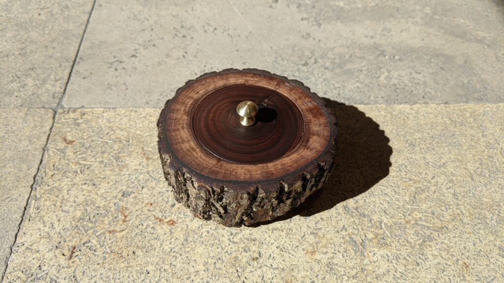 Walnut box with platinum ring with walnut inlay, wood supplied by customer, lid on with mushroom shaped brass handle
