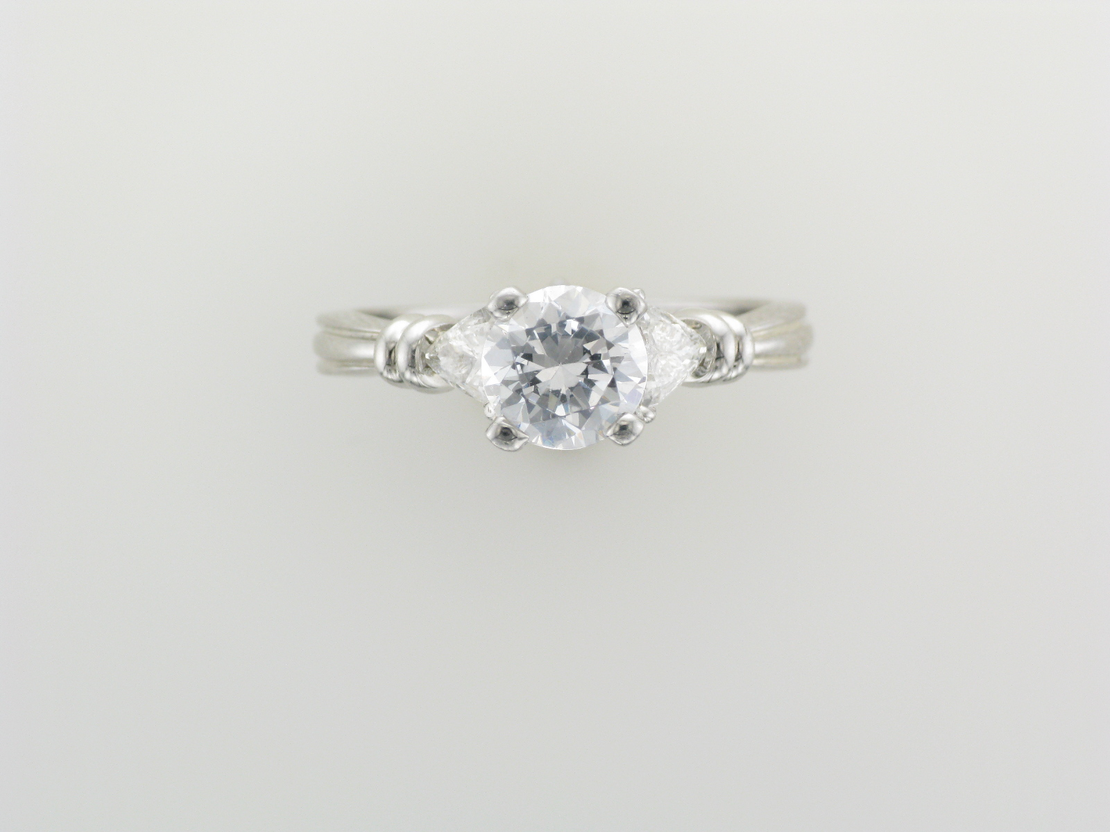 Triangle Side Stone Engagement Ring