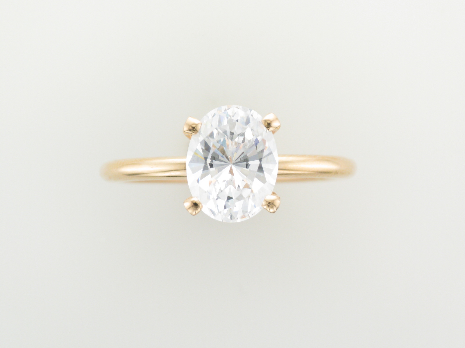Solitaire Oval on Rose Gold Band